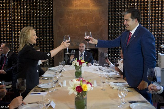 To good company: The two leaders cheers before sitting down to their presumably jovial dinner