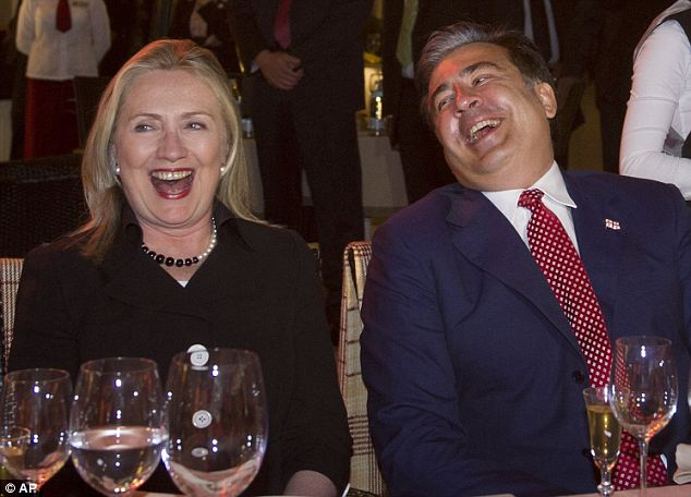 Loads of laughs: Secretary of State Hillary Clinton (left) and Georgian president Mikheil Saakashvili (right) enjoy a joke while they attend dinner and a wine tasting in his home country