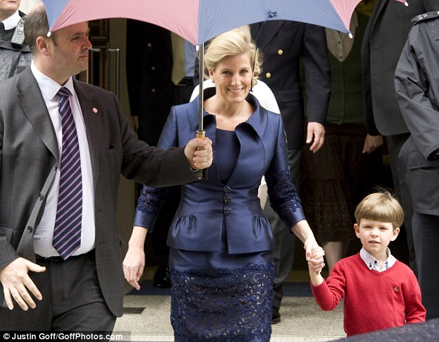 All smiles: Sophie, The Countess of Wessex, is pictured leaving the hospital with her son James