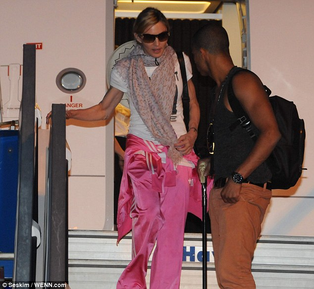 Different looks: The singer emerged wearing a bright pink adidas tracksuit while her beau wore jeans and a vest
