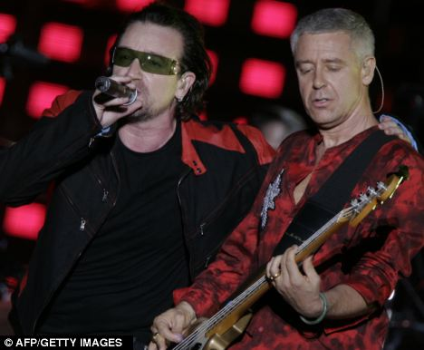 Adam Clayton (right) on stage with Bono during a concert in Buenos Aires, Argentina during their Vertigo tour in 2006