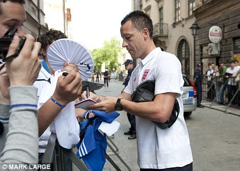 Sombre: Deofe's England team-mates, including defender John Terry, began their preparations in Poland in the absence of the Spurs star