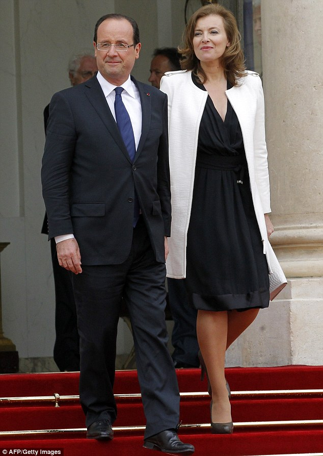 France's president Francois Hollande and his companion Valerie Trierweiler last month. Mrs Trierweiler has returned to work for the first time since Mr Hollande's inauguration