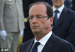 French President Francois Holland  takes part in a ceremony commemorating the 68th anniversary of the D-Day invasion yesterday
