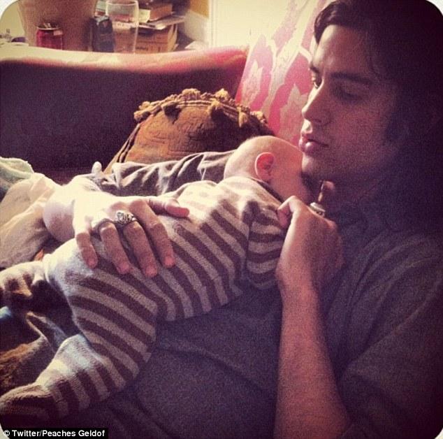 Favourite place to sleep: Astala takes a nap on Thomas Cohen's chest