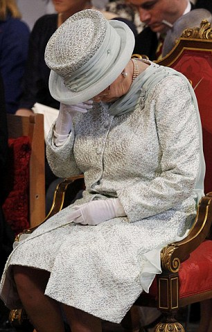 Deprived of the reassuring presence of her husband Prince Philip, who is receiving treatment in hospital, Queen Elizabeth II wipes her eyes during the thanksgiving service at St Paul's Cathedral