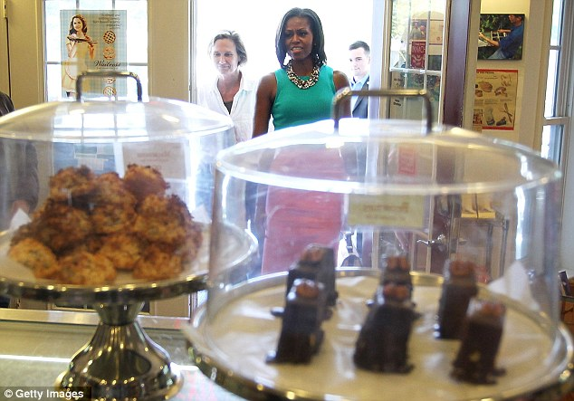 Rest stop: Mrs Obama visited the bakery in the small town of Occoquan, Virginia, after a day's campaigning