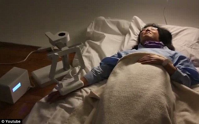 End of the line: As the patient slips away, the robot offers affectionate words of comfort