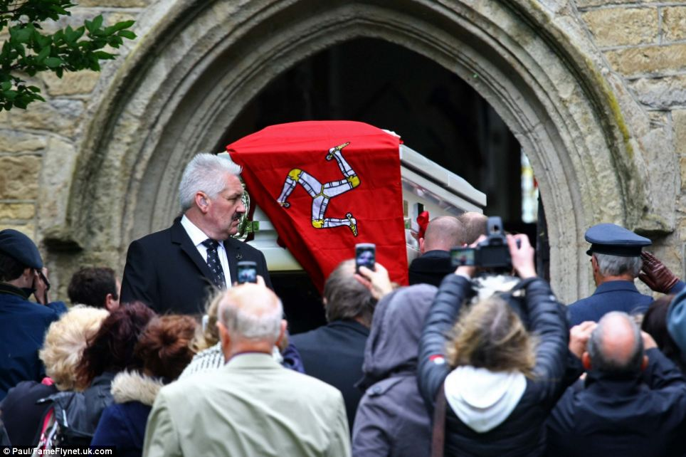 Hometown: A flag of the Isle of Man, where the singer was born, was draped on the coffin
