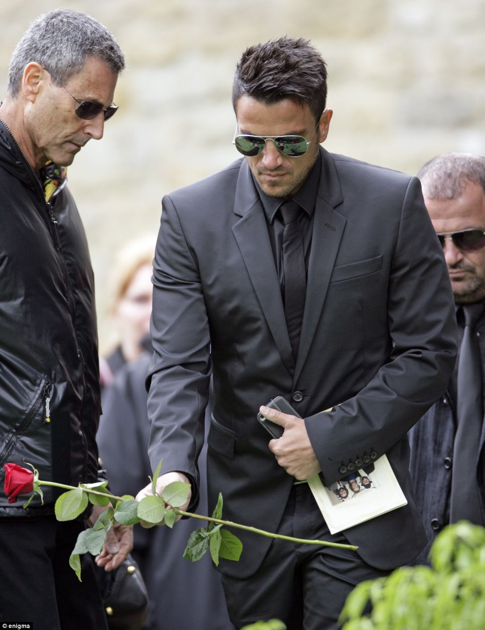 Collaborator: Friend Peter Andre, who the late star wrote a song for recently, both placed roses on the coffin