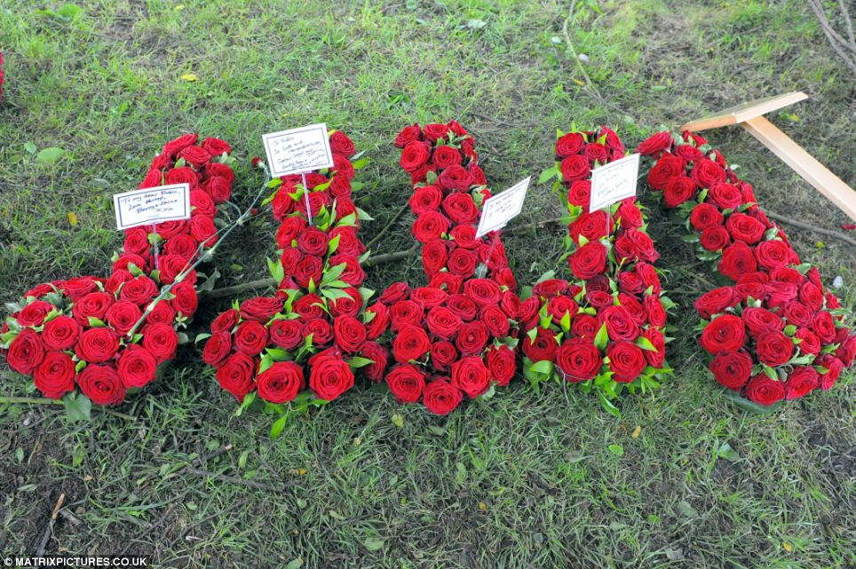 Red rose floral tributes in the shape of musical notes were left to the pop legend
