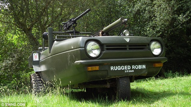 Rugged: The off-roader is fitted with tank-like tracks and heavy artillery including a Browning 50 calibre machine gun
