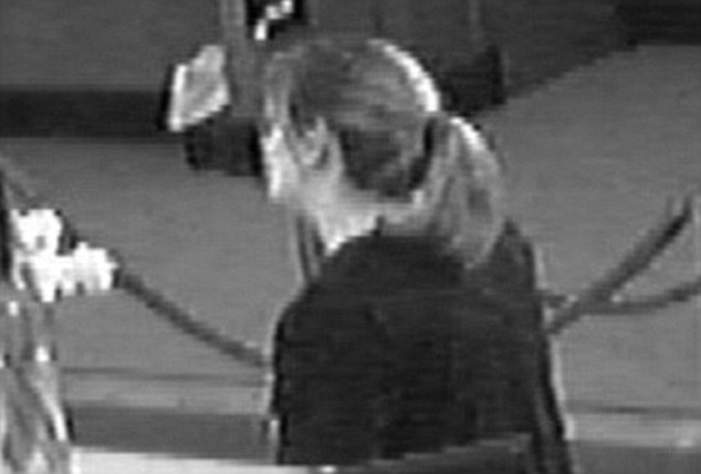 On film: Logan police released this image of Summer Inman working at Century National Bank the day she disappeared