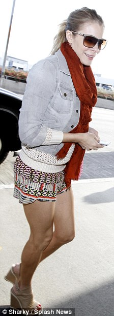 Orange accessories:  The singer's scarf matched with her Emilio Pucci type shorts