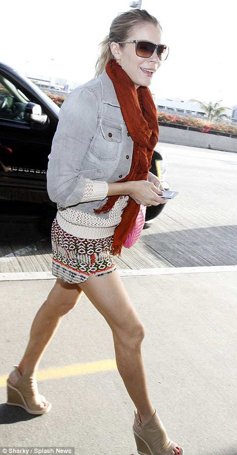 Flaunt it: LeAnn Rimes wore an outfit  that highlighted her legs as she ran to catch a flight in Los Angeles today
