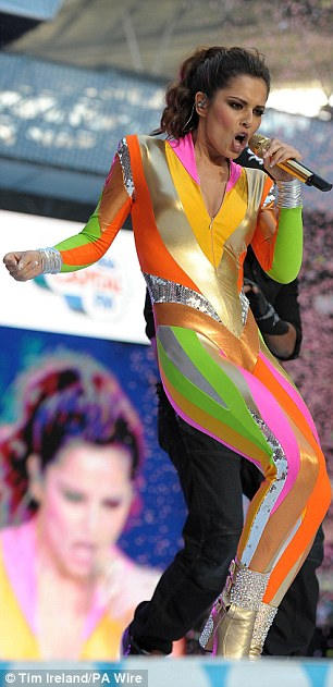 Oh Cheryl! The singer puts on an energetic performance although nothing could distract from that outfit