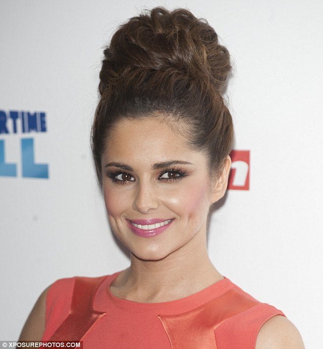 That's more like it! Cheryl looked cute in a coral dress with a high bun after her performance
