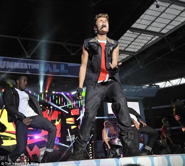 Teenage girls everywhere swoon as Justin sings Boyfriend
