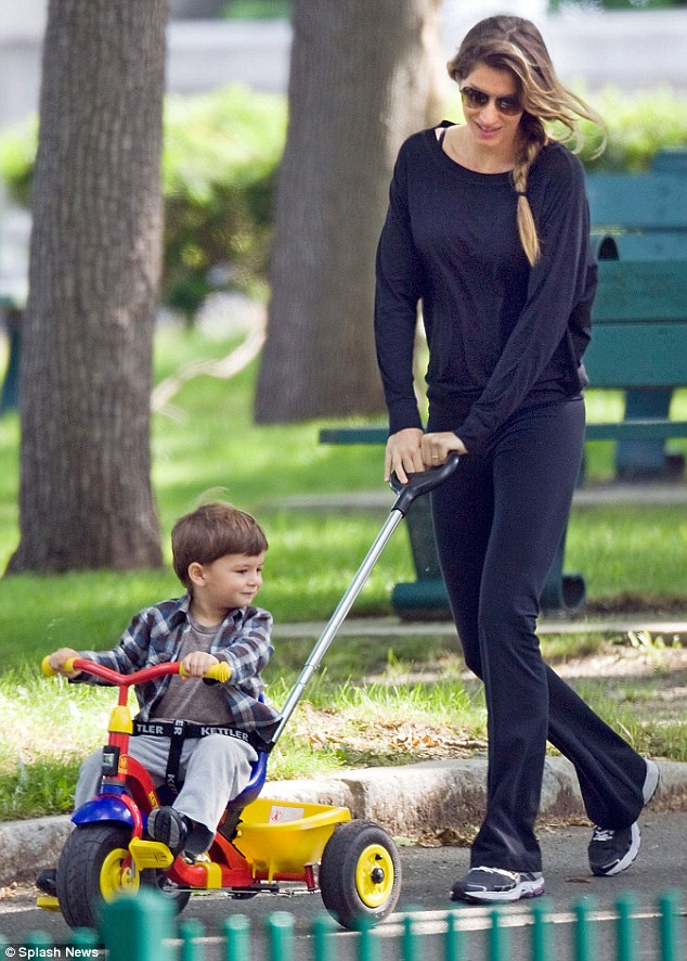 This is fun: Gisele with son Benjamin having a great time taking a spin around the park in Boston last week