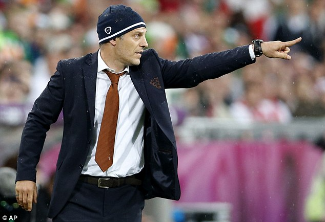 Hats off to you: Slaven Bilic barks orders at his Croatia team from his technical area
