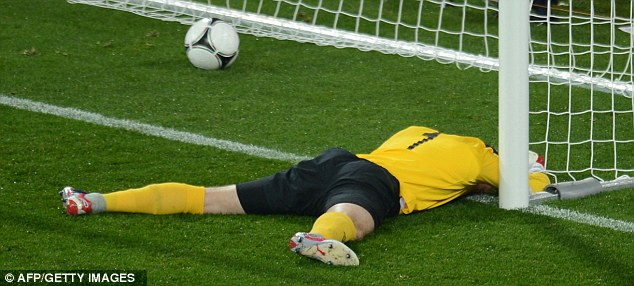 Helpless: Shay Given could do very little about the ball bouncing off his head for Croatia's third goal