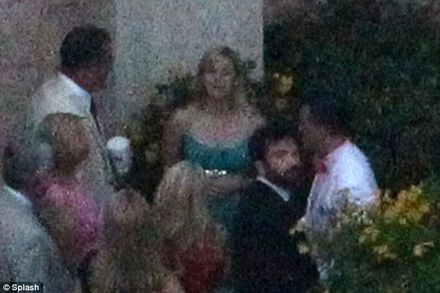 Celeb-filled: Reese Witherspoon was spotted in the crowd of guests who arrived for the intimate ceremony (wearing green)
