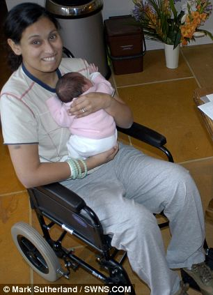 Bally Taylor in a wheelchair with Amara in 2008