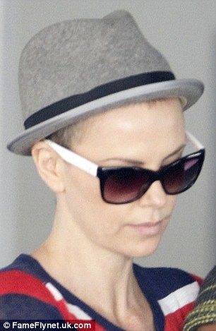 Hair today gone tomorrow: Charlize looked dramatically different to the blonde siren that attended the Prometheus premiere in London less than a fortnight ago