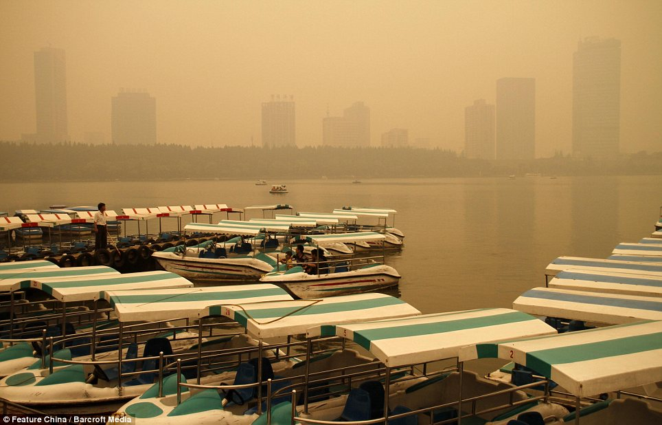 Foggy: The boats in Xuanwu Lake, in Nanjiing, are blanketed by the yellow haze