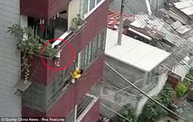 In a remarkably similar case another child was rescued after a man scaled the side of a building to rescue a toddler whose head got stuck in railing