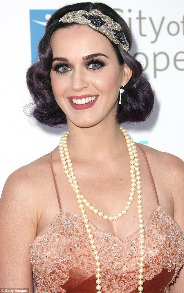 Immaculate: Katy's lipstick defined her pout while her dark eye make-up brought out the green of her iris