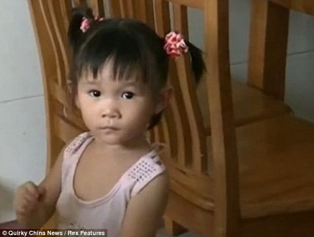 The two-year-old girl was lucky not to have fallen to her death following the incident in Zhaoqing, southern China