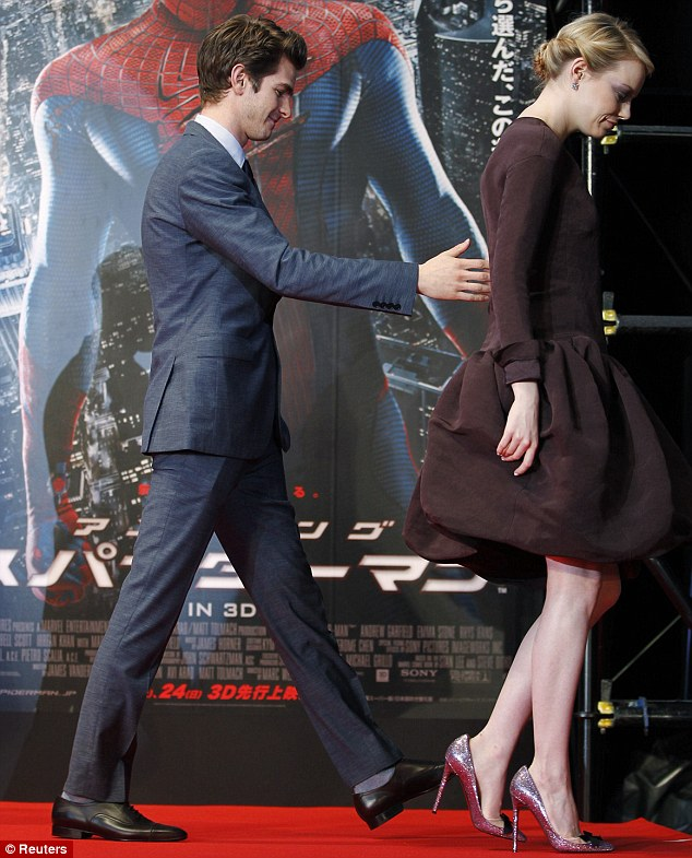Careful, dear: Andrew helps girlfriend Emma down the steps at the world premiere of the summer blockbuster