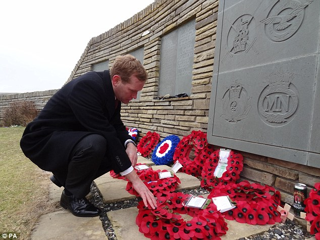 Never forgotten: Foreign Office minister Jeremy Browne joined veterans to lay a wreath in memory of those who died in 1982