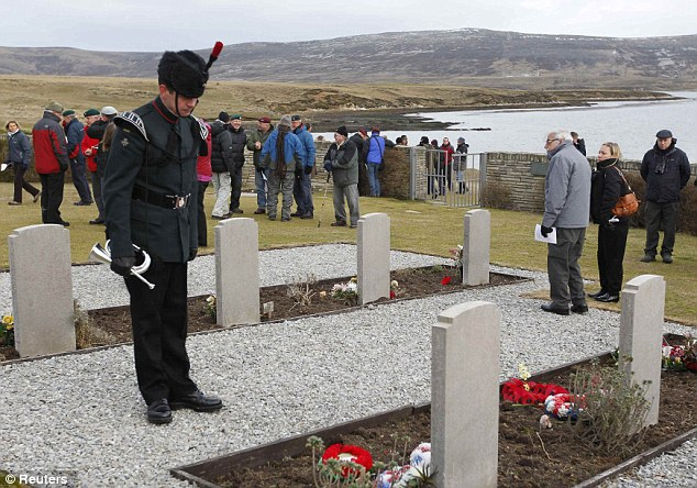 Quiet reflection: Local residents joined the British veterans to pay homage to the dead
