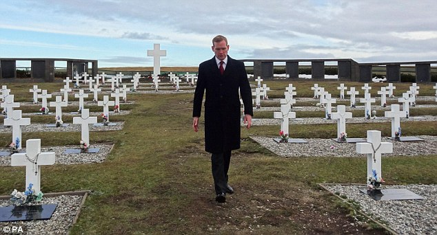 Attentive: Jeremy Browne also visited the Argentine cemetery at Darwin, on the island of East Falkland