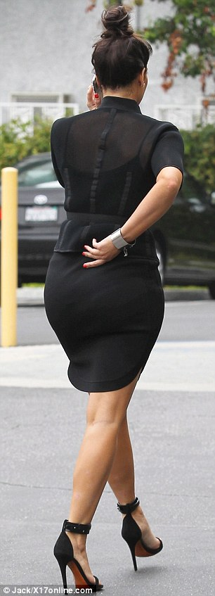 Leggy: Kim looked leggy as she stepped out for a business meeting in a very tight pencil skirt and sky-high black stilettos