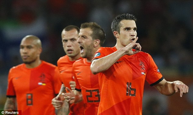Shhhh: Van Persie celebrates his strike - but it could not help Holland salvage a point