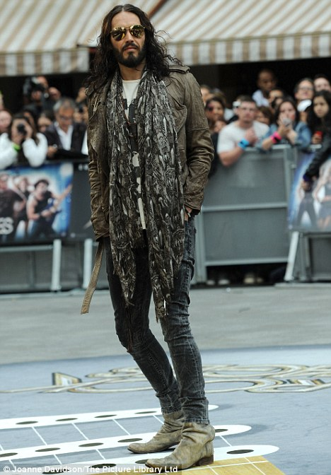 Back to his old ways: Russell Brand has admitted he's dating again following his split from wife Katy Perry... and would be happy to marry again