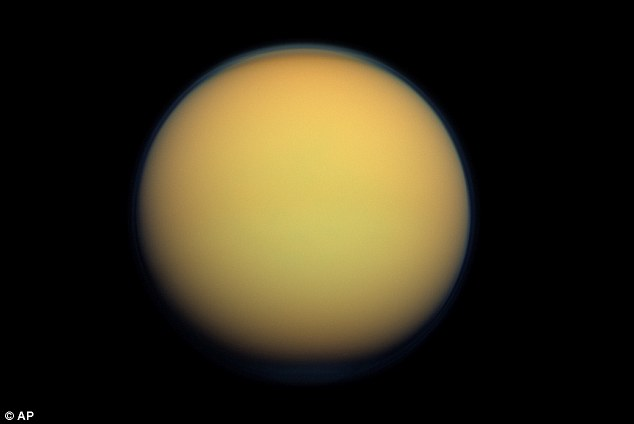 Yellow moon: Another Nasa photograph of Titan.  Scientists have been surprised at the findings having previously thought lakes only existed at the poles