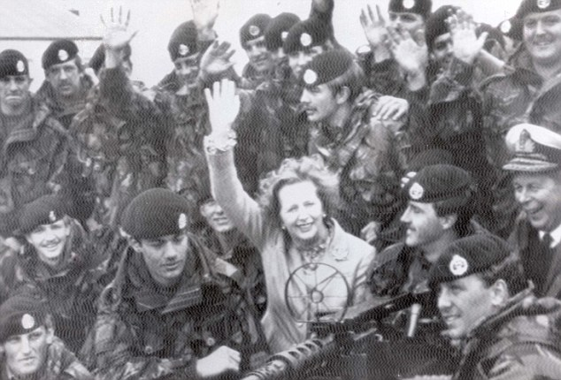 Rousing welcome: Mrs Thatcher is surrounded by troops on a visit to Goose Green in January 1983, where the Parachute Regiment had secured a crucial victory seven months earlier