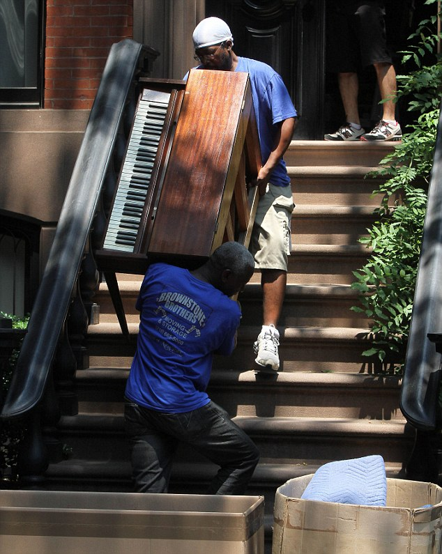 Pulling out all the stops: Movers were seen bringing a piano into the actress's Big Apple home especially for the visit on Monday