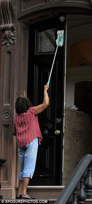 Spic and Span: A cleaner was spotted doing the very last bits dusting around Parker's front door
