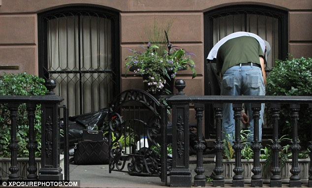 Final touches: The plants were later potted in the front of the beautiful brownstone