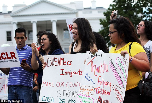 Supporters; Immigration activists gather in front of the White House to celebrate the announcement