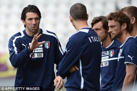 Worried: Italy goalkeeper Gianluigi Buffon (left) in training in Krakow