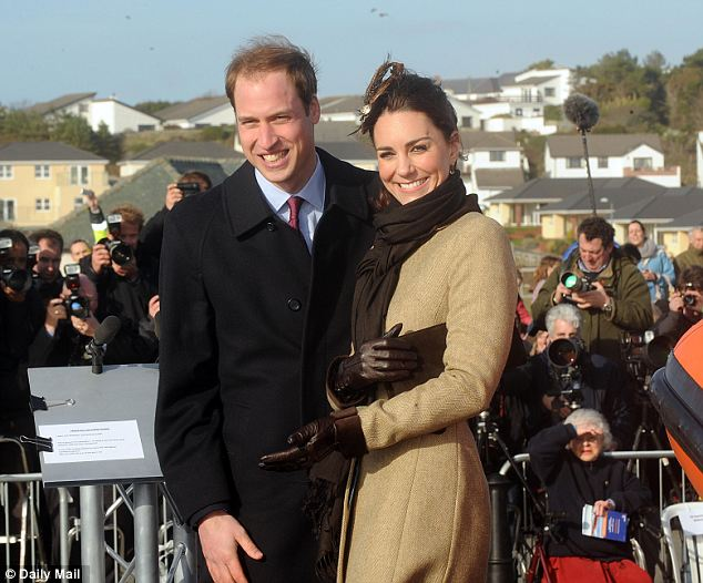 Happy at home: Prince William and Kate Middleton at their first official engagement last year launching a new RNLI lifeboat at Trearddur Bay Lifeboat Station near their residence in Anglesey, North Wales