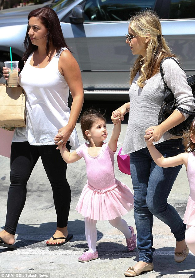 Pretty in pink: The little girls linked up to their guardians' hands following the lesson