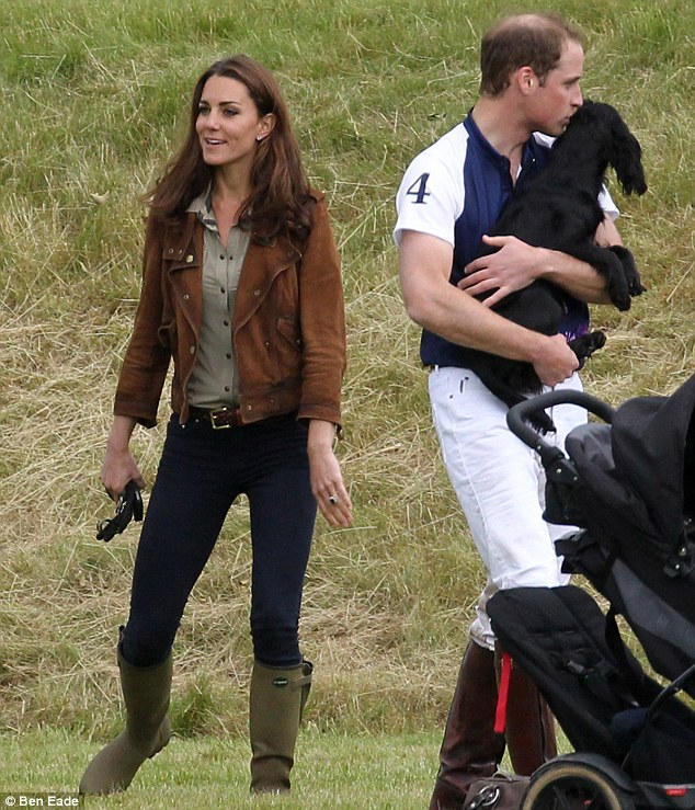 Prince William with his black cocker spaniel, Lupo, at the Beaufort Polo Club in Gloucestershire today