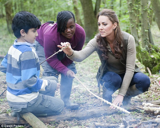 Kate tried some of the food the children had made on their campfire